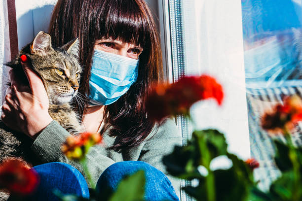 Virus a woman is sitting with a cat in a protective gauze mask from picture id1209886695?b=1&k=6&m=1209886695&s=612x612&w=0&h=6taxpw1wchp06ccmmwhyjzru0qugdxpcvhivsjqb8sw=