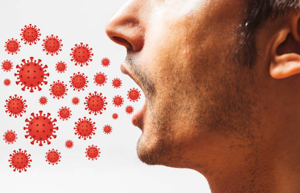Virus coming out from mouth - Health Concept stock photo