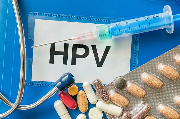 HPV virus desease concept. Many pills, syringe and stethoscope around. HPV virus desease concept. Many pills, syringe and stethoscope around. human papilloma virus stock pictures, royalty-free photos & images