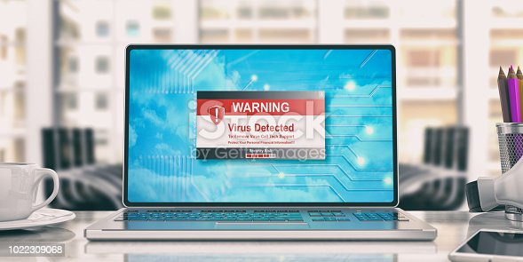 istock Virus detected message on laptop in an office. 3d illustration 1022309068