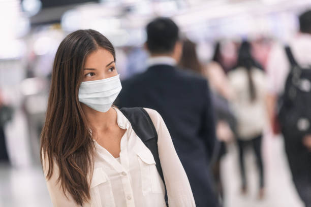 virus mask asian woman travel wearing face protection in prevention for coronavirus in china. lady walking in public space bus station or airport - disbarment stock pictures, royalty-free photos & images