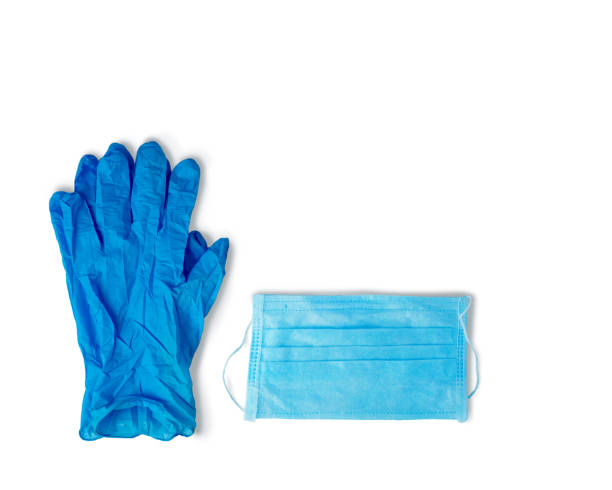 virus protection. blue rubber gloves and a medical mask on a white background. virus protection. blue rubber gloves and a medical mask on a white background latex stock pictures, royalty-free photos & images