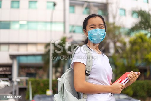 People with face mask. Concept with copy space. Portrait of adult woman in quarantine of flu. Photo on the street in the city. Picture for coronavirus covid-19 (SARS-CoV-2)