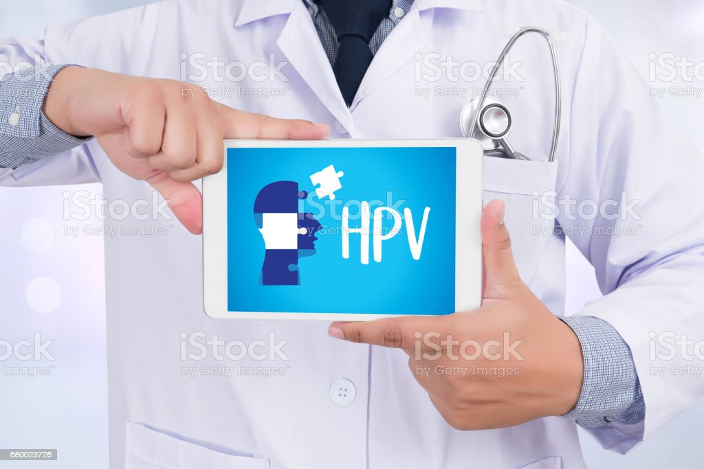 HPV CONCEPT Virus vaccine with syringe HPV criteria for pap smear slide cytology. stock photo