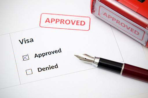 istock Visa and approved stamp on a document form 859461910