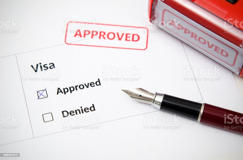 Visa and approved stamp on a document form stock photo