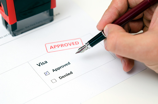 istock Visa and approved stamp on a document form 859461932