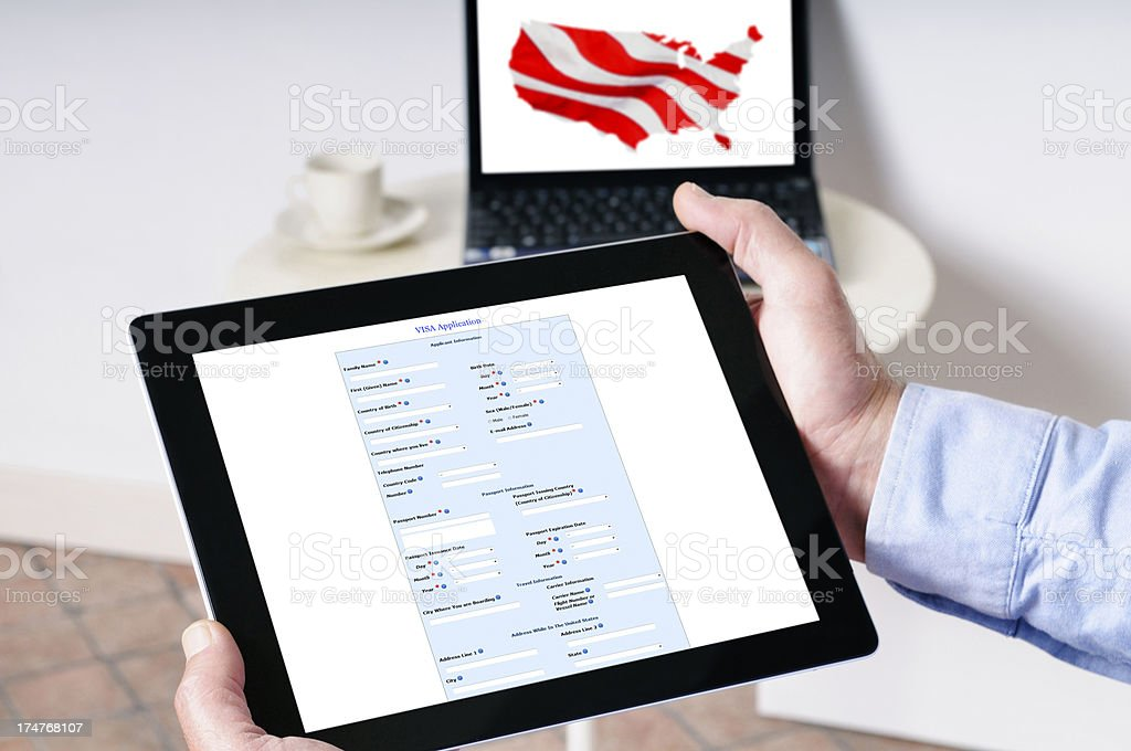 Visa Application on Digital Tablet stock photo