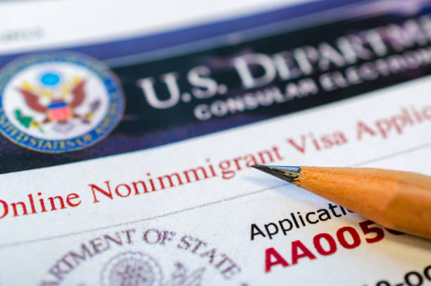USA visa application Online non-immigration visa application form with a pencil passport stamp stock pictures, royalty-free photos & images