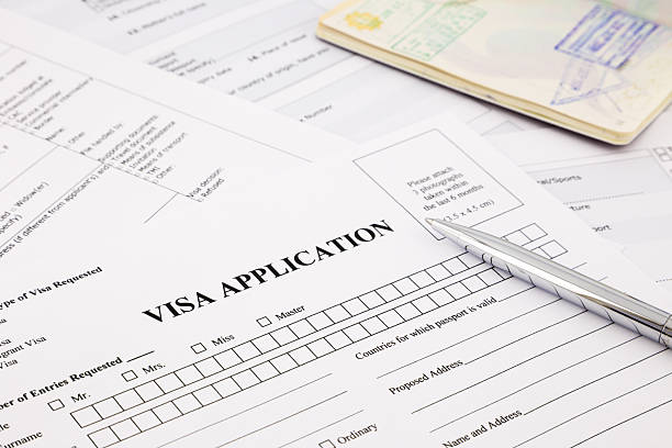 Visa application visa application form and passport, apply and permission for foreigner country passport stamp stock pictures, royalty-free photos & images