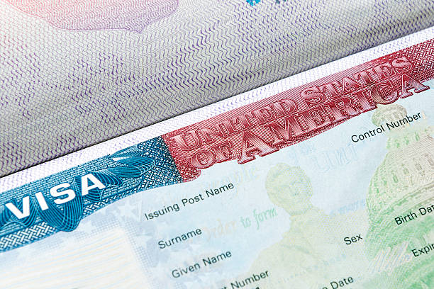 USA visa in passport Close up of United Kingdom visa in passport passport stamp stock pictures, royalty-free photos & images