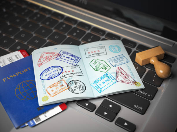 Visa online application concept. Open passport with visa stamps with airline boarding pass tickets and stamper on the computer keyboard. Visa online application concept. Open passport with visa stamps with airline boarding pass tickets and stamper on the computer keyboard. 3d illustration passport stamp stock pictures, royalty-free photos & images