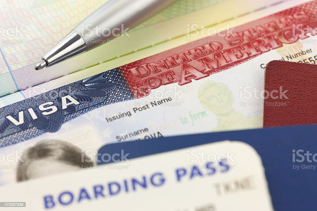 USA Visa, passports, boarding pass and pen - foreign travel stock photo