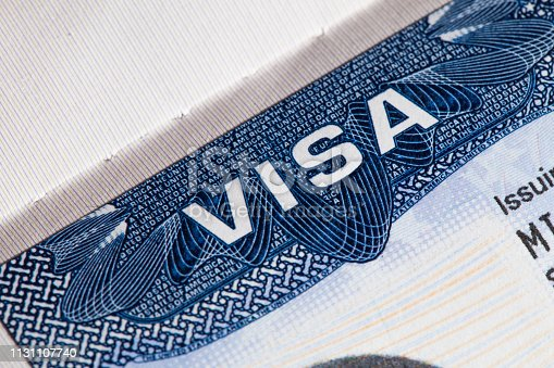 Travel USA visa in passport close-up. American multi entrance visa in passport.