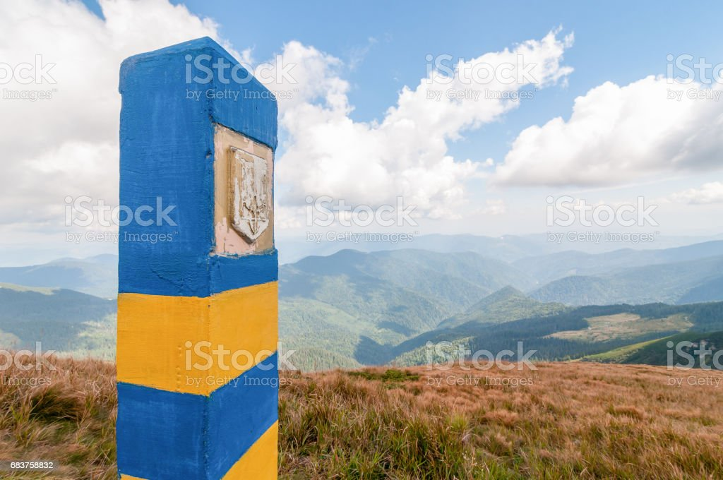 Visa-free regime concept. Border pillar on Ukrainian frontier at Carpatian montain. Ukraine got free visa travel status stock photo