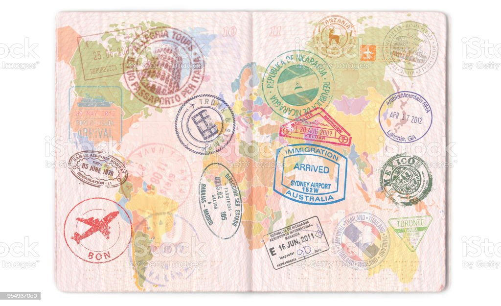 Visas, stamps, seals in the passport. World map, travel stock photo
