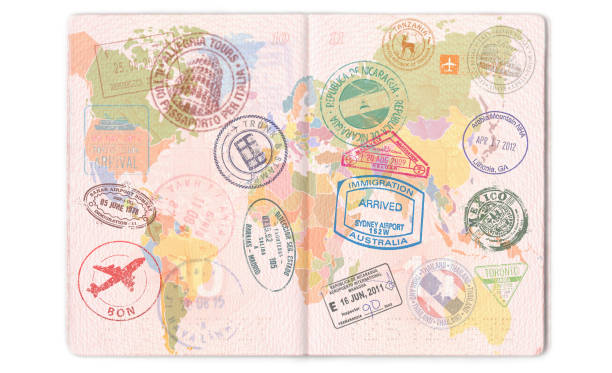 visas, stamps, seals in the passport. world map, travel - passport stock photos and pictures