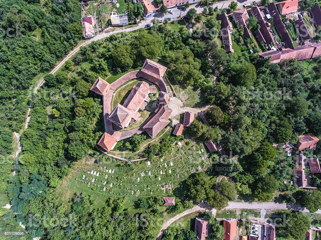 Viscri church as seen from above. Aerial view from a stock photo