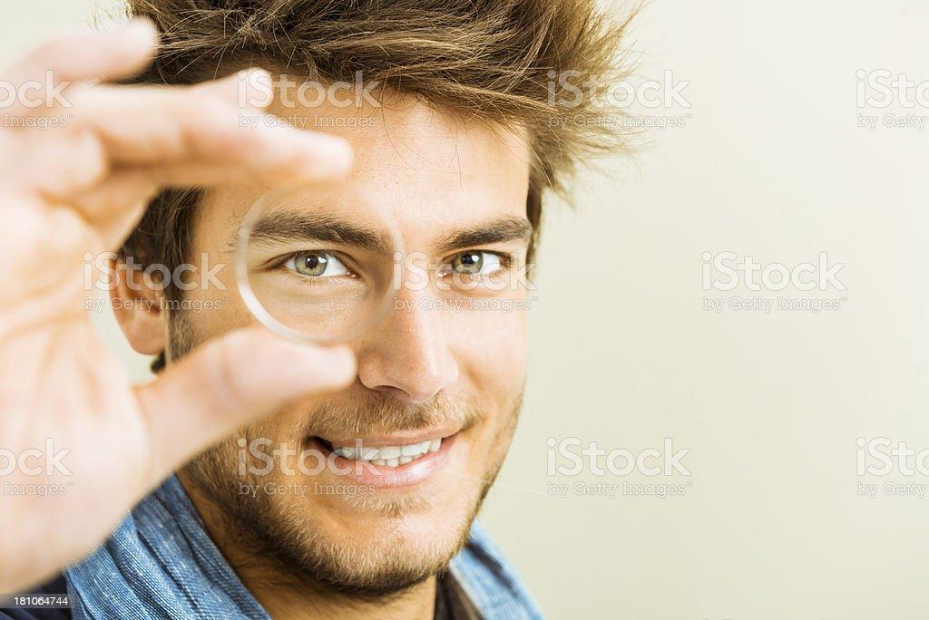 Vision: man looking through a lens stock photo