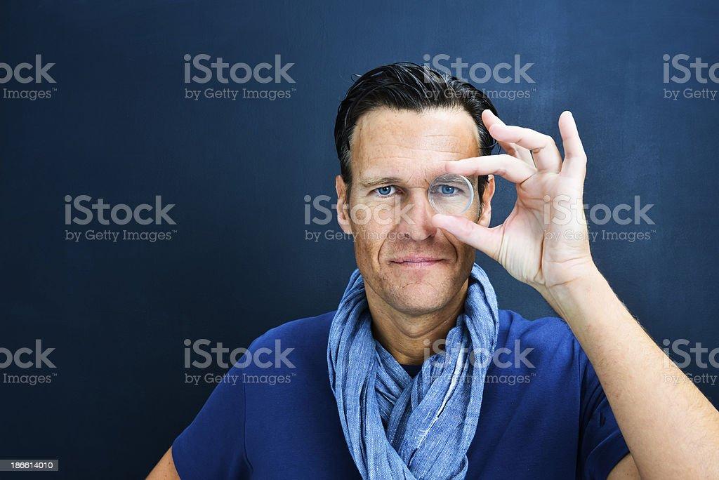 Vision: man looking through lens royalty-free stock photo