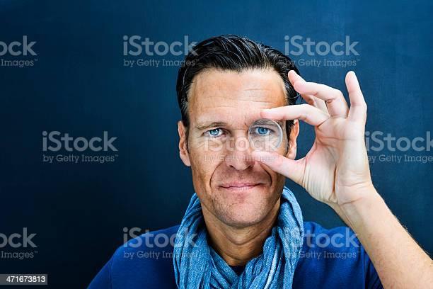 Vision man looking through lens picture id471673813?b=1&k=6&m=471673813&s=612x612&h=bvv8svptim1qgvw8ozbdbgjcfk86c88ccpkjn4dmxq8=