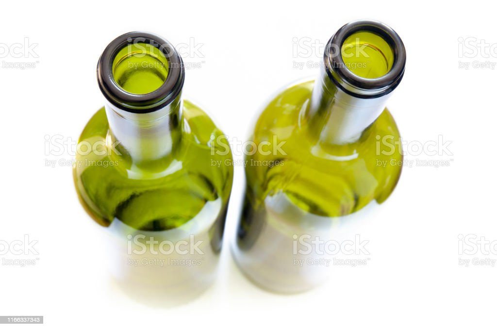 Vision of Bottles from Above Top view, from above, of green glass bottles with a strong selective focus effect, isolated on white background Abstract Stock Photo