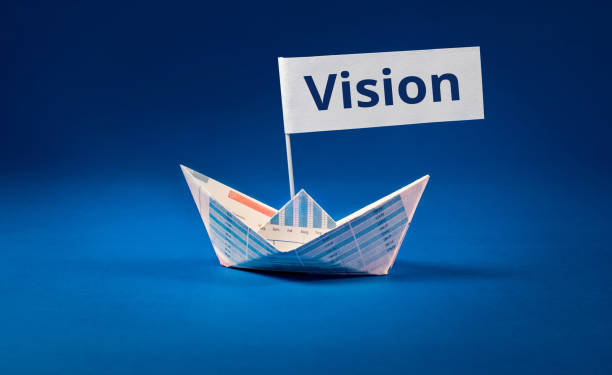 Vision word with Boat paper graph on blue ocean.Business concept. stock photo