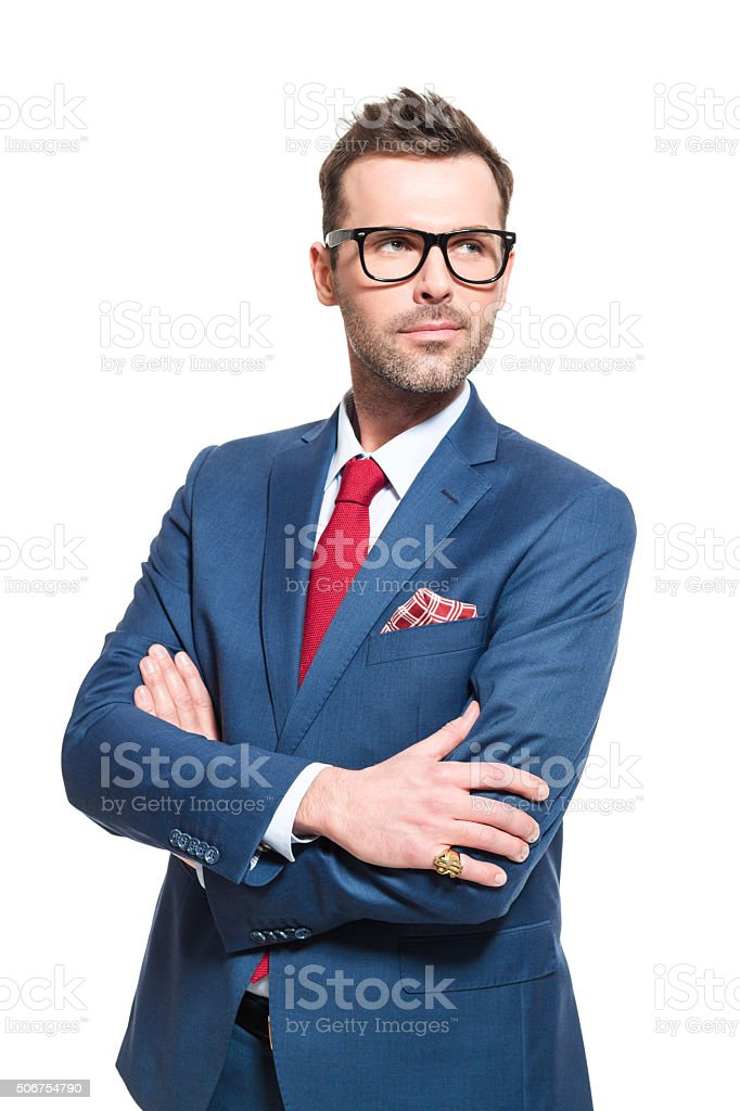 Visionary leader. Businessman wearing elegant suit and glasses Portrait of elegant CEO wearing elegant suit and nerd glasses, looking away with vision. Studio shot, one person, white background. Adult Stock Photo