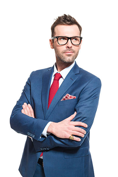 Visionary leader. Businessman wearing elegant suit and glasses Portrait of elegant CEO wearing elegant suit and nerd glasses, looking away with vision. Studio shot, one person, white background. smirking stock pictures, royalty-free photos & images