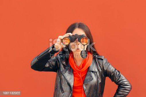 istock Visionary Millennial Girl Looking through Binoculars 1051132022