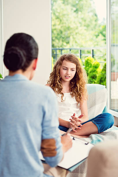 visit a psychologist - teen counseling stock photos and pictures