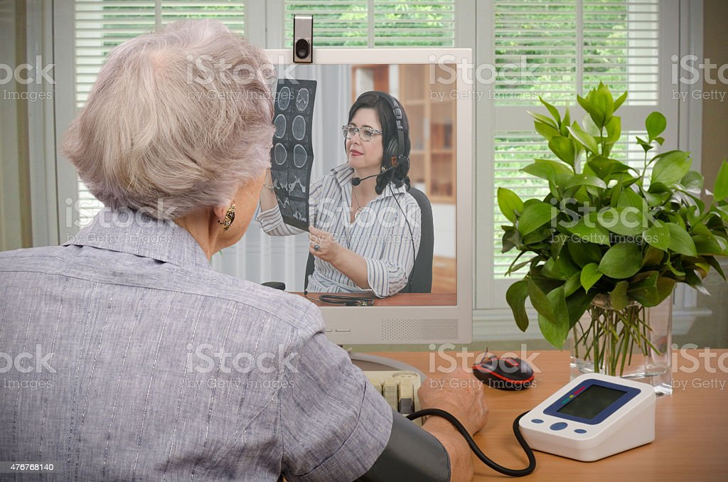 Visit to virtual doctor stock photo