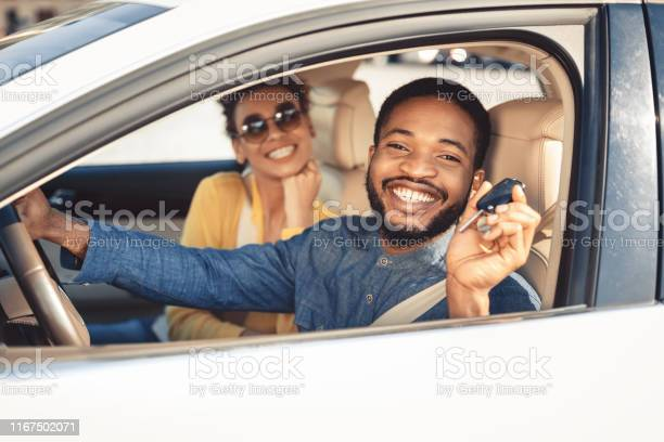 Visiting car dealership afro couple showing car key picture id1167502071?b=1&k=6&m=1167502071&s=612x612&h=vi8ehkklz zjx hlo0oknlpi vn6zs1caoaodkoh508=