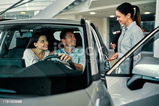 1049198210 istock photo Visiting car dealership. 1191003568
