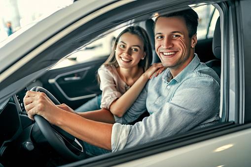 istock Visiting car dealership. 1191003631