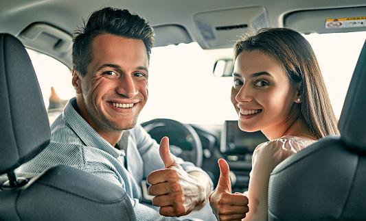 istock Visiting car dealership. 1191003634
