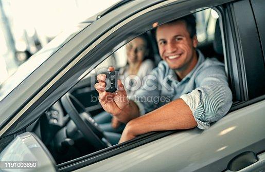 664521270 istock photo Visiting car dealership. 1191003650