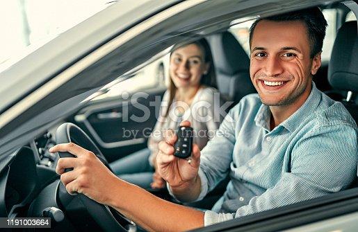 664521270 istock photo Visiting car dealership. 1191003664