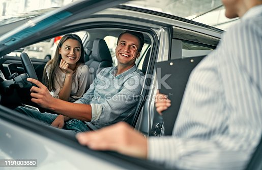 1049198210 istock photo Visiting car dealership. 1191003680