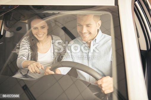 664521270 istock photo Visiting car dealership 664520566