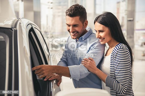 664521270 istock photo Visiting car dealership 664521492