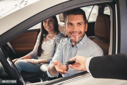664521270 istock photo Visiting car dealership 664521858