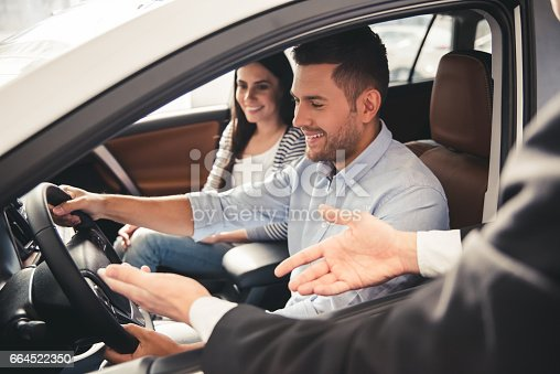 664521270 istock photo Visiting car dealership 664522350