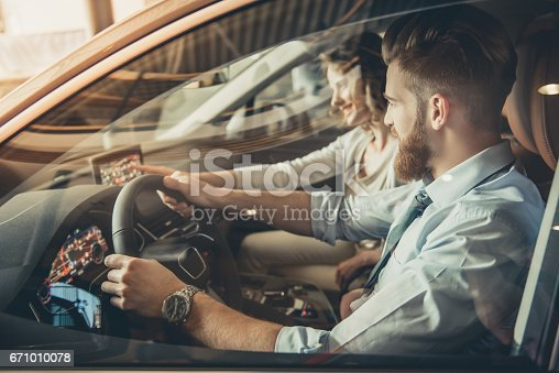 664521270 istock photo Visiting car dealership 671010078