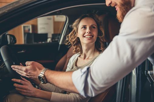 Visiting Car Dealership Foto de stock y más banco de imágenes de Adulto