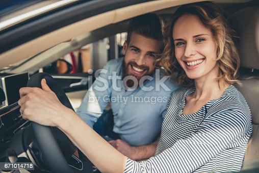 671035278istockphoto Visiting car dealership 671014718