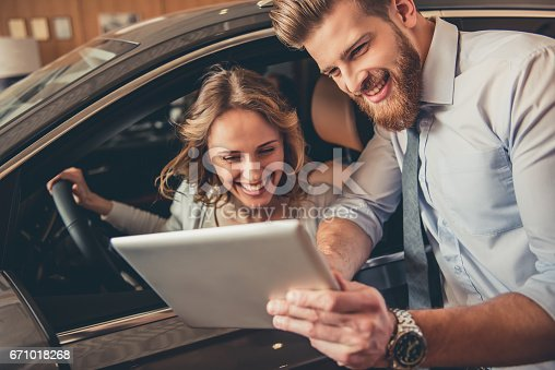 671035278istockphoto Visiting car dealership 671018268