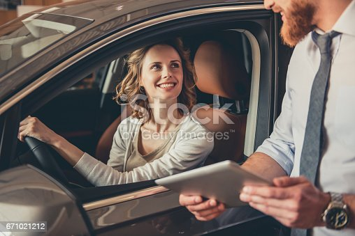671035278istockphoto Visiting car dealership 671021212