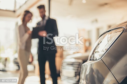 istock Visiting car dealership 671021358