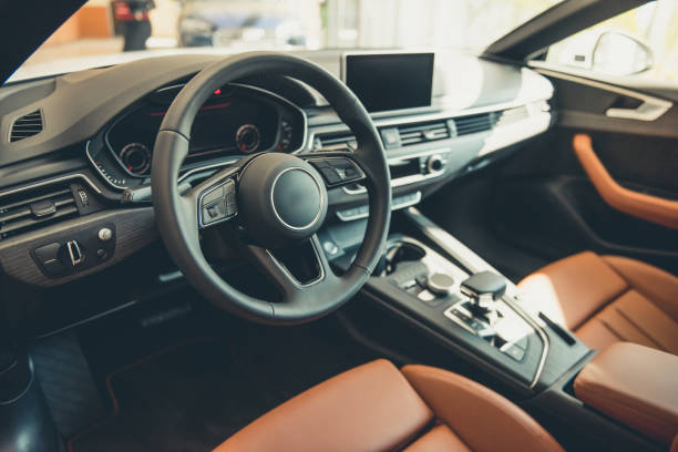 visiting car dealership - car interior stock photos and pictures